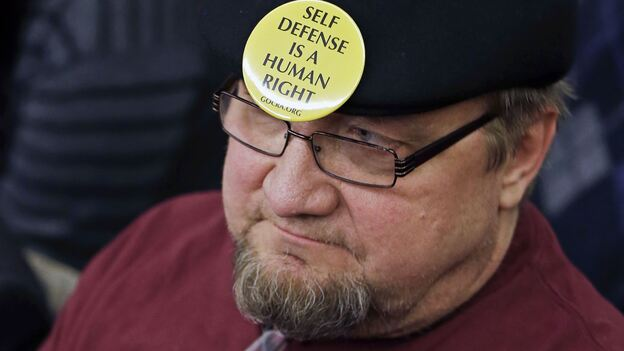 Gun rights advocate Andy Cers of Minneapolis listens to testimony during a Minnesota House hearing on gun violence bills Tuesday in St. Paul. (AP)