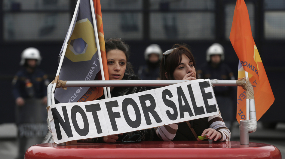 Employees of Hellenic Postbank protest during a strike against the bank's privatization in Athens, in December.