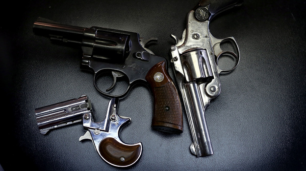 More than 400 guns, including these three, were turned in during a Dallas gun buyback program in January. But determining the effectiveness of such programs is difficult due to limits on gun-related research. (Getty Images)