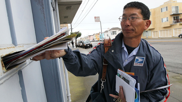 Letter carrier Raymond Hou delivering mail on his route in San Francisco (March 2010 file photo). (Getty Images)
