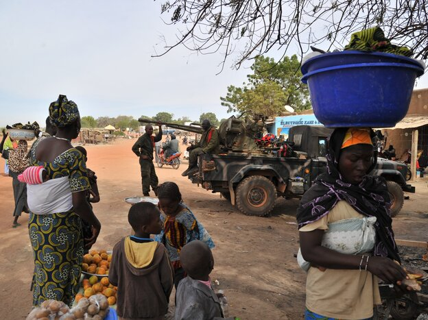 """Malian soldiers patrol in Diabaly, Mali on Jan. 22, 2013. Dialaby was one of the places referred to as a """"village"""" on NPR."""