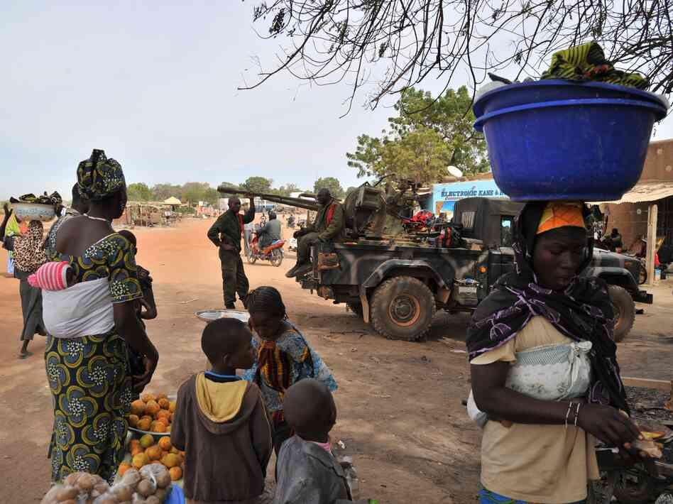 "Malian soldiers patrol in Diabaly, Mali on Jan. 22, 2013. Dialaby was one of the places referred to as a ""village"" on NPR."