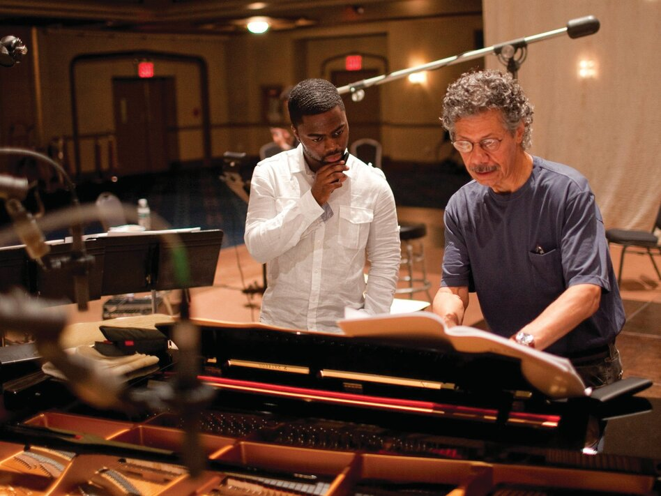 Chick Corea discusses a passage with Marcus Gilmore during the recording sessions for the two-disc set The Continents. Corea recently recorded another album featuring Gilmore. (Courtesy of the artist)