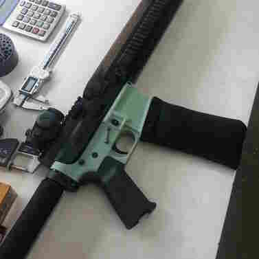 This AR-15 rifle's lower receiver (in soft green color) was produced with a 3-D printer. The 3-D printing industry has criticized the use of the technology for gun part making.