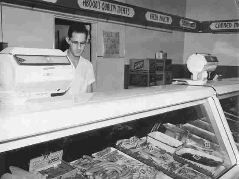 The author's uncle, Hannibal Abood, worked the meat counter at the family's grocery store in the 1940s.