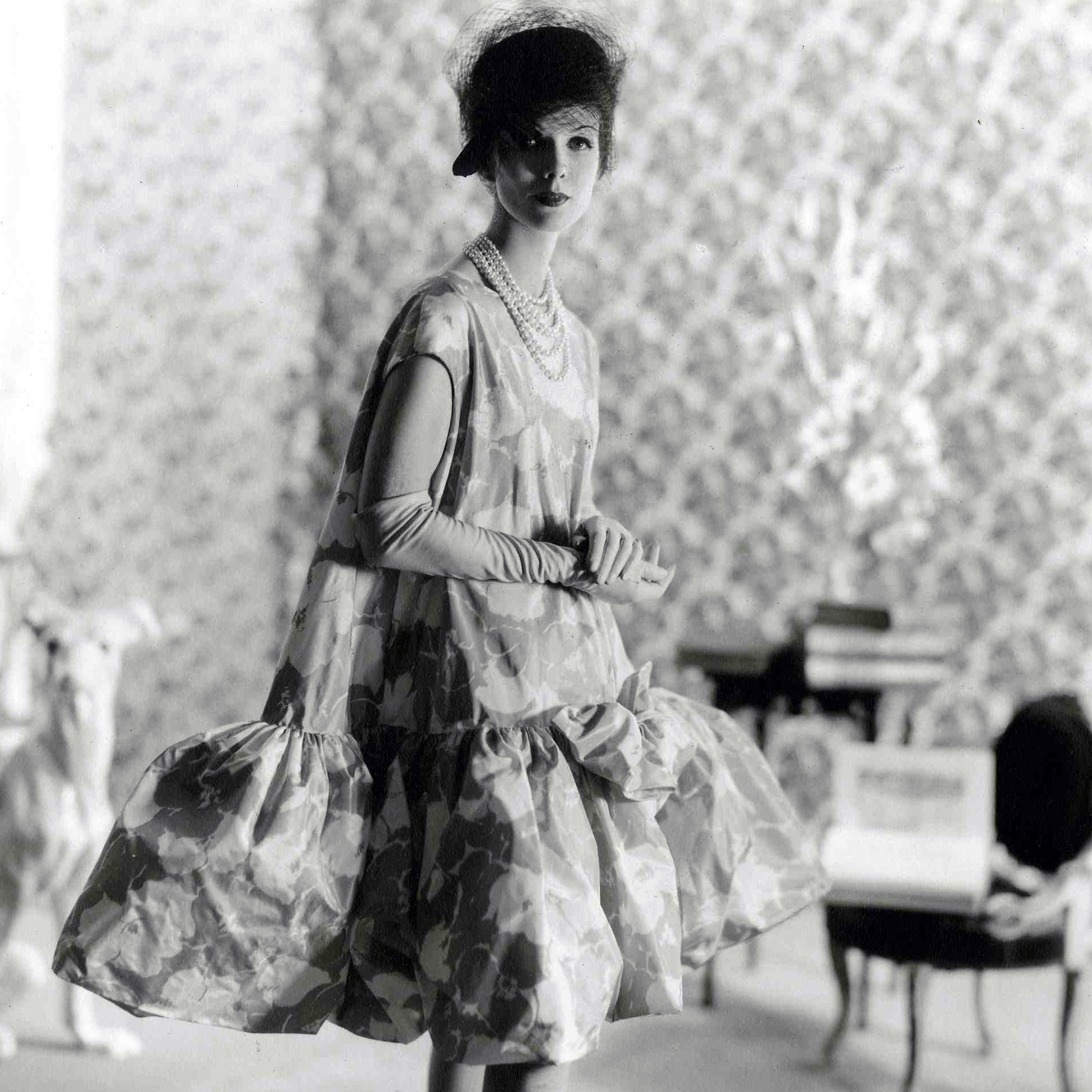 "Balenciaga debuted his baby doll dress in 1958. Blume writes, ""all women benefited -- and benefit still -- from the principal achievement of [Balenciaga's] 1950s lines: the elimination of a tight nipped-in waist and the smoother, more yielding silhouette."""