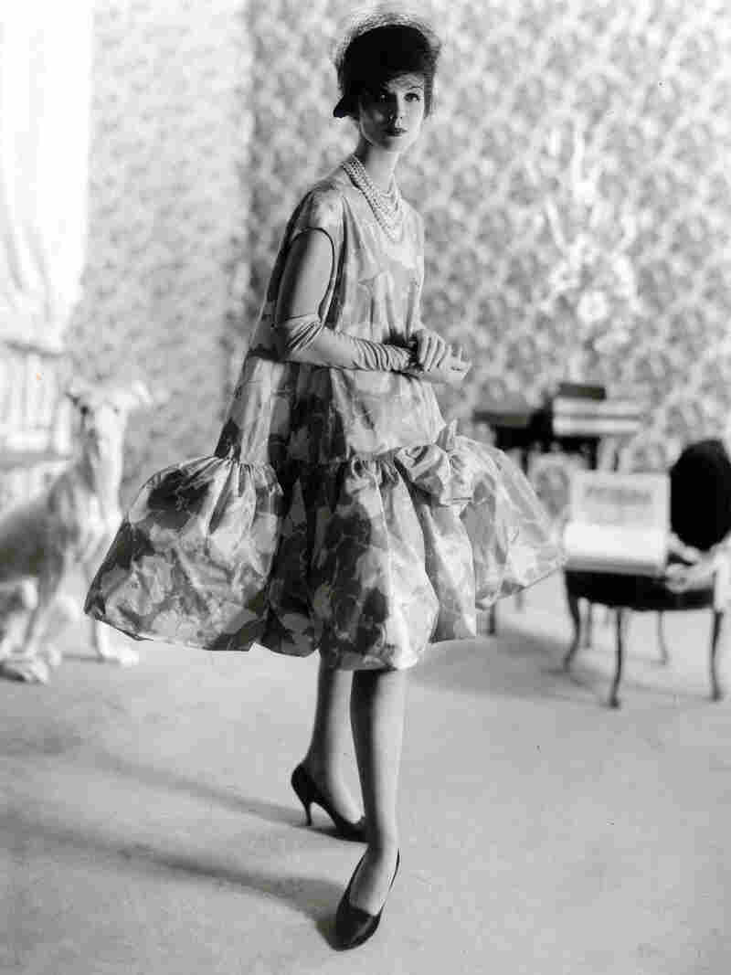 """Balenciaga debuted his baby doll dress in 1958. Blume writes, """"all women benefited — and benefit still — from the principal achievement of [Balenciaga's] 1950s lines: the elimination of a tight nipped-in waist and the smoother, more yielding silhouette."""""""