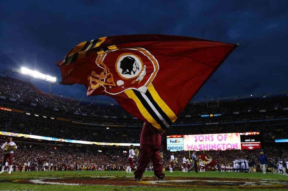A Washington Redskins flag is waved prior to the NFC Wild Card Playoff Game against the Seattle Seahawks at FedExField in January.