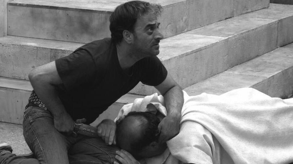 Brutus (Salvatore Striano) fixes a wild stare at the witnesses and conspirators after Julius Caesar's murder, in a scene from Paolo and Vittorio Taviani's <em>Caesar Must Die.</em>