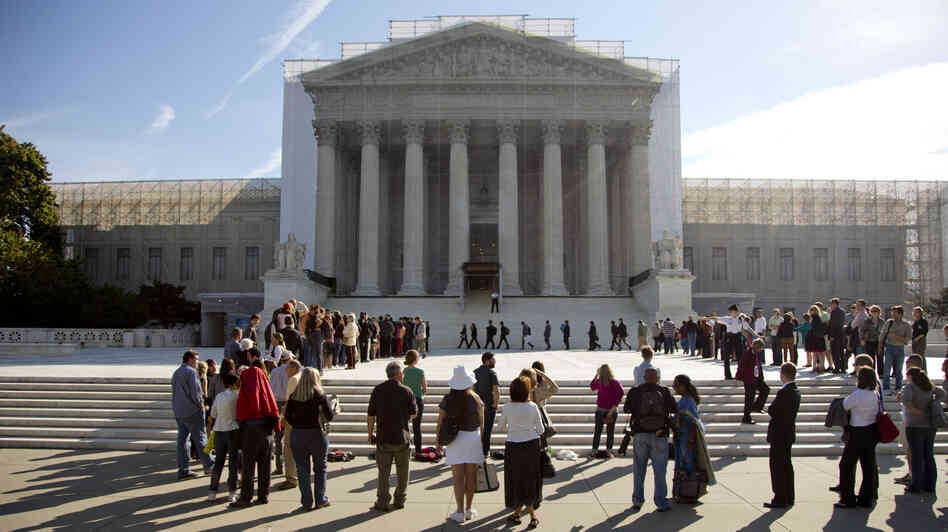 People wait in line to enter the Supreme Court as the term began in October.