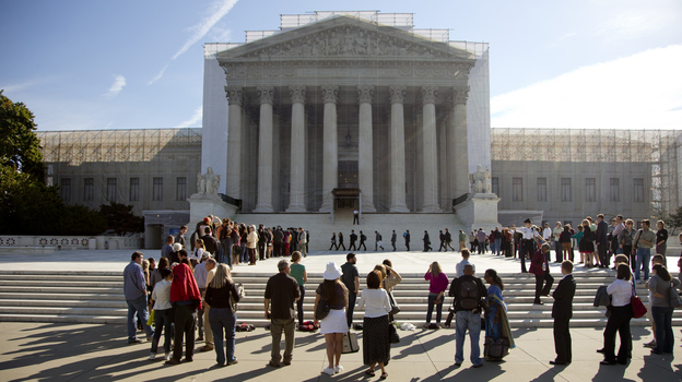 People wait in line to enter the Supreme Court as the term began in October. (AP)