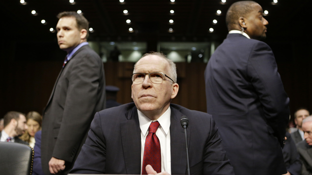John Brennan, President Obama's nominee to head the CIA, prepares to testify at his confirmation hearing before the Senate Intelligence Committee on Thursday. (AP)