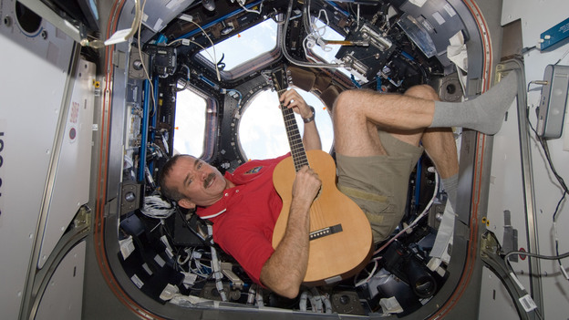 Canadian Space Agency astronaut Chris Hadfield strums his guitar, a Larrivee Parlor, on the International Space Station in December. (NASA)