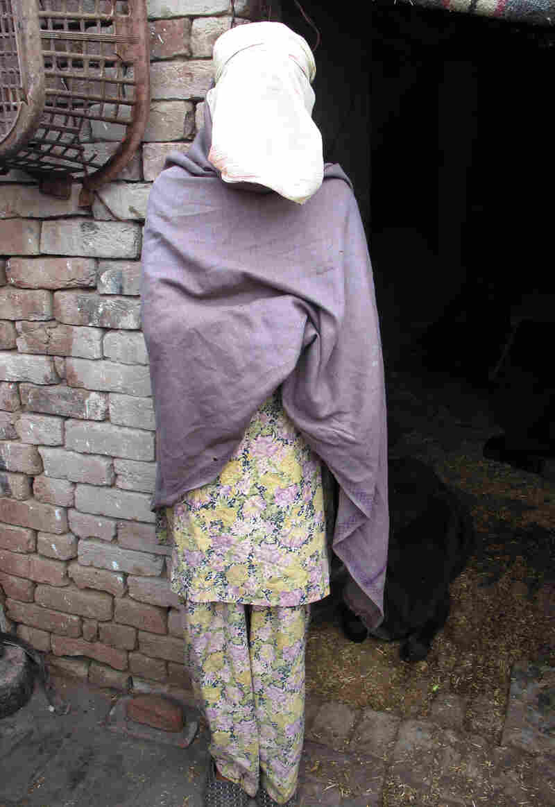 Roopa, the pseudonym for a gang rape victim in rural India, is shown at her home in the state of Haryana. Police were reluctant to investigate initially and the community has ostracized her. But her family has stood by her as she presses the case.