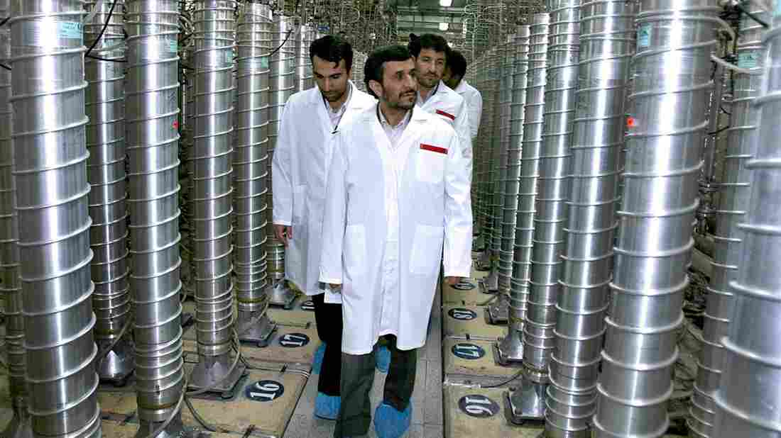 Iranian President Mahmoud Ahmadinejad (center) visits a uranium enrichment facility in Natanz, Iran, in 2008. Enriching uranium requires many fast-spinning centrifuges, arranged in what's called a cascade.