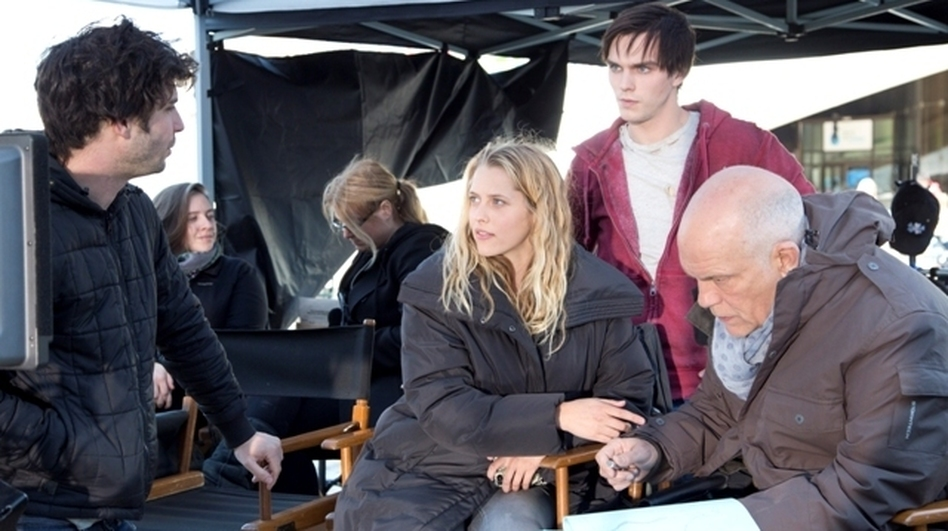 Director Jonathan Levine (far left) offers script notes to Teresa Palmer, Nicholas Hoult and John Malkovich on the set of Warm Bodies. (Summit Entertainment)