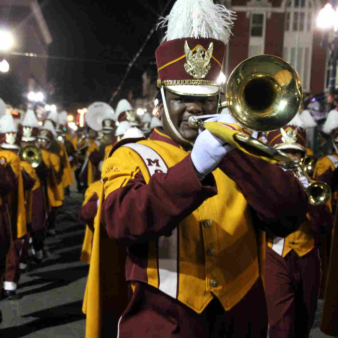 High School Marching Bands Lay Down The Beat Of Mardi Gras