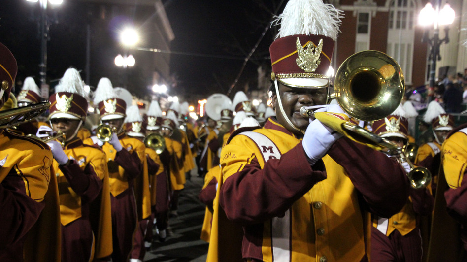 The McDonogh 35 High School band marches in a parade to usher in the Carnival Season. (Keith O'Brien for NPR)