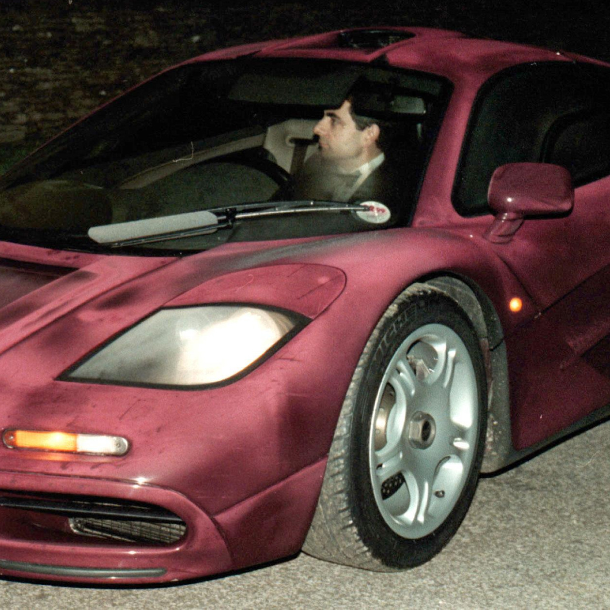 Before the crash: Rowan Atkinson at the wheel of his McLaren F1 in 1998.