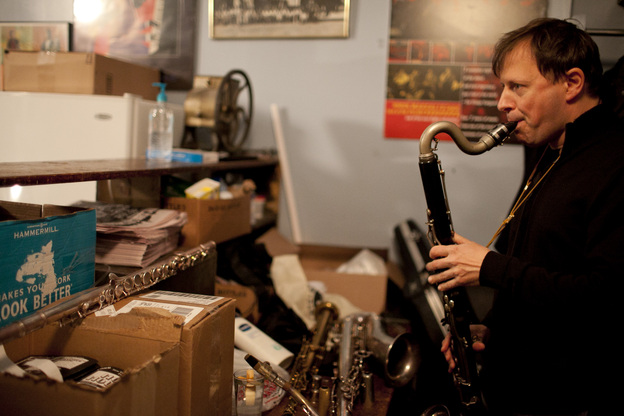 Chris Potter, backstage, warming up on bass clarinet.