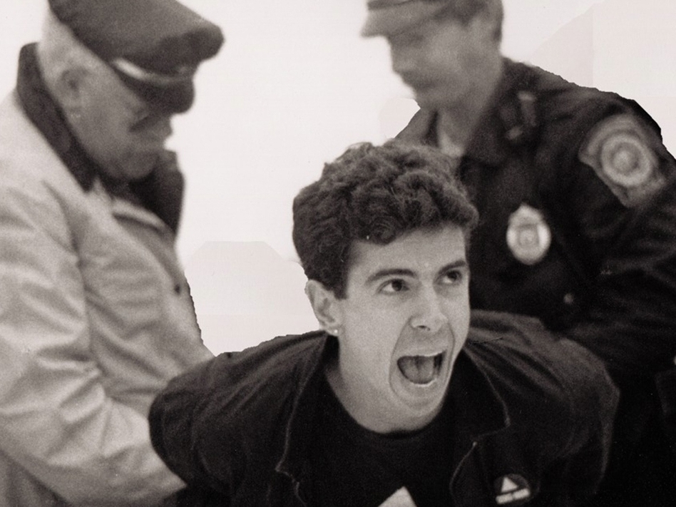 Director and producer David France chronicles the efforts of HIV/AIDS activists in the '80s and '90s in his documentary <em>How to Survive a Plague. </em>Above, AIDS activist Peter Staley is arrested in a scene from the film.<em></em> (William Lucas Walker)