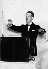 "1919, London, England, UK --- Professor Leo Theremin with his invention, one of the first electronic instruments, ""Music from the Ether"", which has become known simply as a ""theremin"". --- Image by � Hulton-Deutsch Collection/CORBIS"