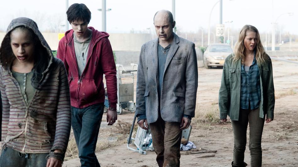 Nicholas Hoult, Rob Corddry and Teresa Palmer lurch through a scene in Levine's zombie romantic comedy. (Summit Enterainment)