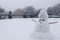 A snowman sits on the duck pond in the Boston Common as snow falls in Boston.