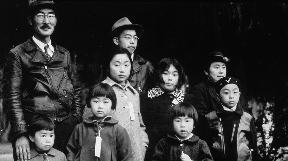 Members of the Japanese-American Mochida family await relocation to an internment camp, in Hayward, Calif., during World War II. In 1942, President Franklin Roosevelt used an executive order to authorize the internment of Americans of Japanese ancestry. In 1988, the U.S. government formally apologized. (Getty Images)