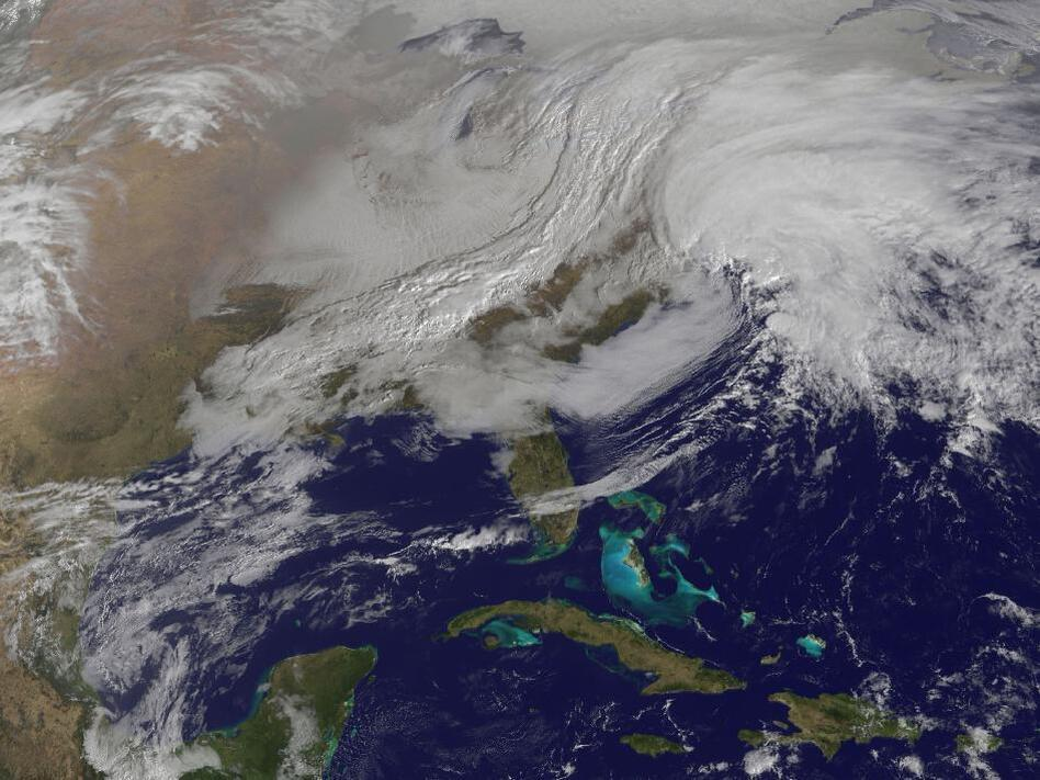 A massive winter storm is coming together as two low pressure systems are merging over the U.S. East Coast. A satellite image from NOAA's GOES-13 satellite on Feb. 8 shows a western frontal system approaching the coastal low pressure area.