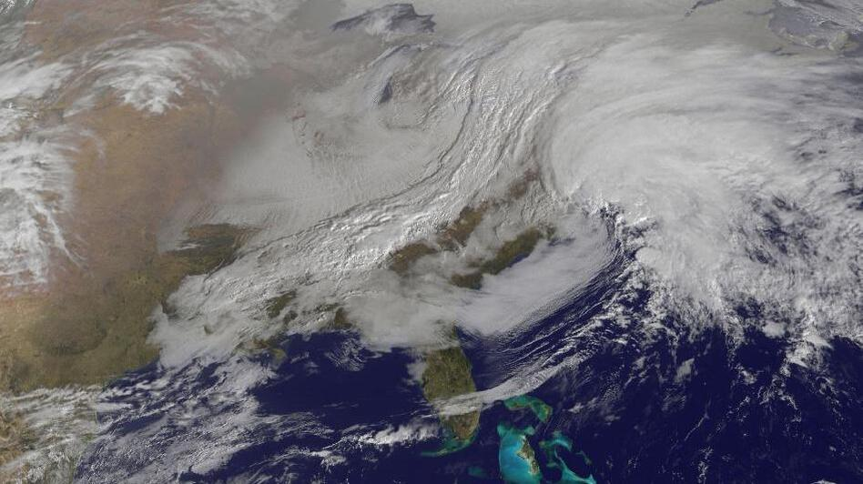 A massive winter storm is coming together as two low pressure systems are merging over the U.S. East Coast. A satellite image from NOAA's GOES-13 satellite on Feb. 8 shows a western frontal system approaching the coastal low pressure area. (NASA)