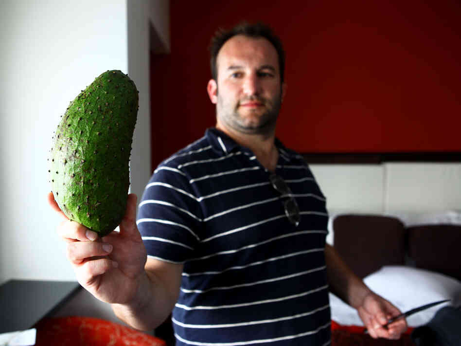 NPR host David Greene shows off a guanabana purchased after a long search for one in Puerto Rico.
