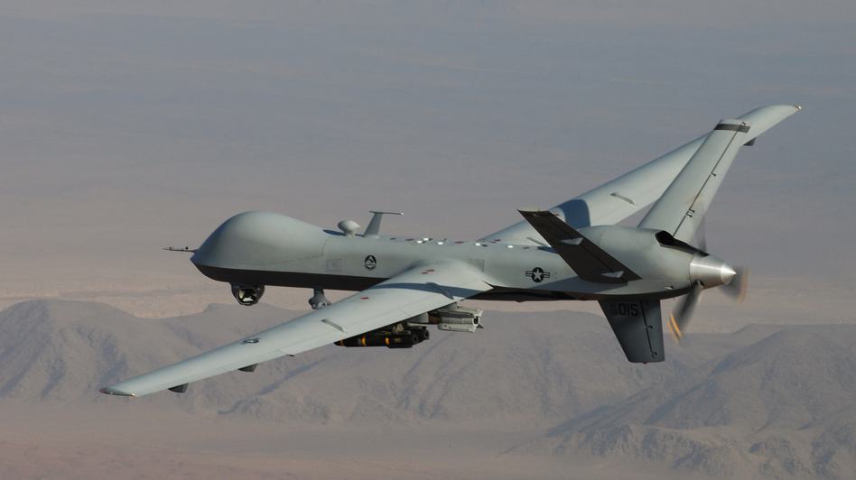 An unmanned drone armed with Hellfire missiles is shown over southern Afghanistan. A Hellfire missile fired from a drone was used in 2011 to kill an American in Yemen who the Obama administration says was an al-Qaida leader. Another American died in that attack, and a 16-year-old American was killed in a separate drone strike. (AP)