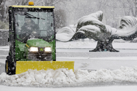 Kevin Quick plows a slushy mix in front of a bank during the storm in Buffalo, N.Y. In some parts of upstate New York, snow fell early Friday morning and was expected to increase throughout the day, with the heaviest accumulations expected in eastern New York on Friday night.