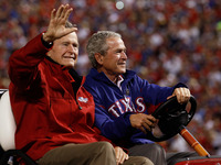 Former presidents George H.W. Bush (left) and George W. Bush at a 2010 World Series game in Arlington, Texas.
