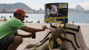 An artist on Rio de Janeiro's Copacabana beach puts the final touches on a sand sculpture of the kissing bug, which spreads Chagas' disease. The sculpture was part of an event in 2009 commemorating the 100th anniversary of the discovery of the disease.