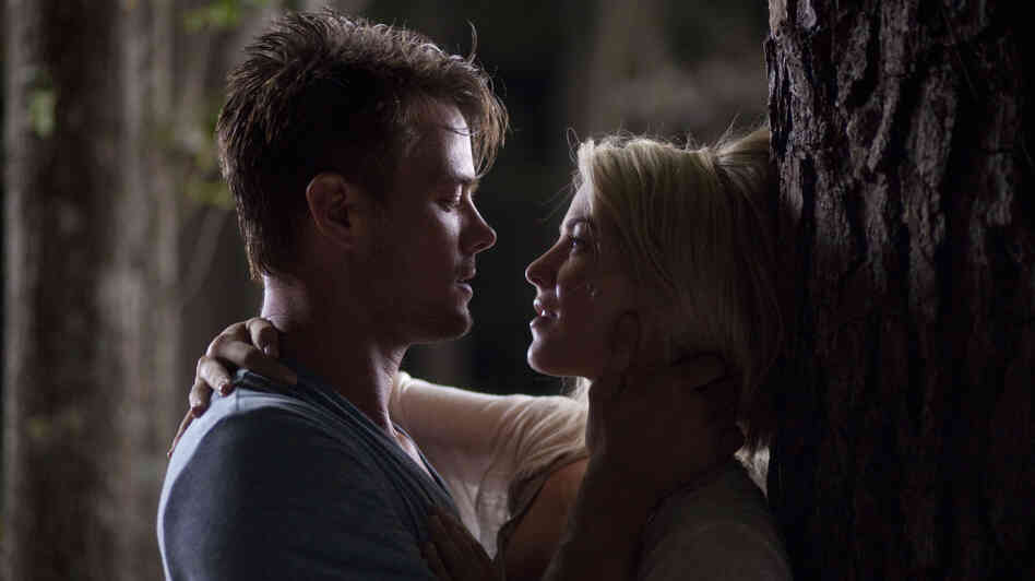 Josh Duhamel and Julianne Hough as Alex and Katie in Safe Haven, the latest Nicholas Sparks' romance novel to be turned into a film.