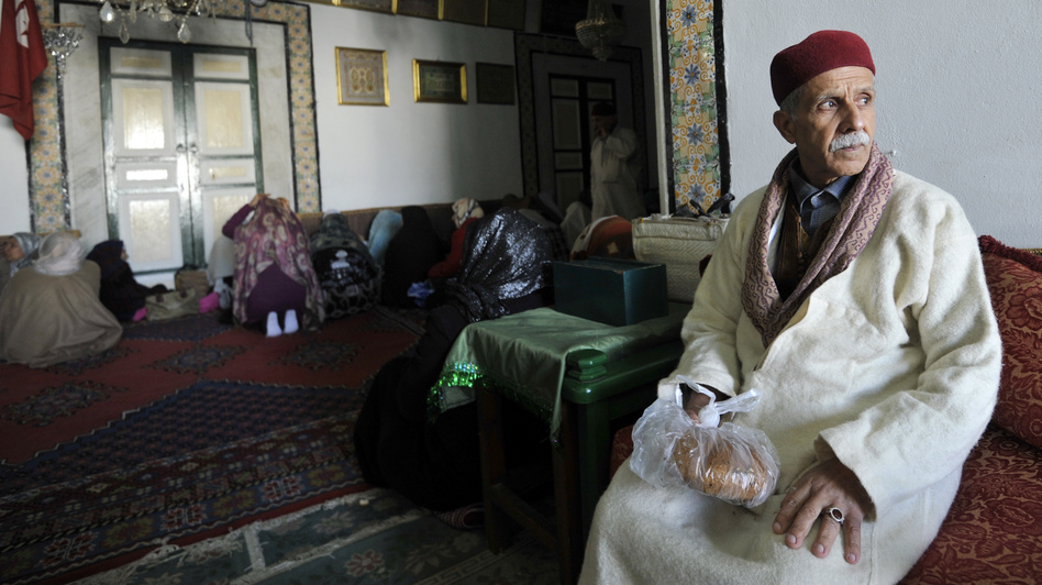 A Sufi man sits during his visit to a shrine in Tunis. Tunisia's government has promised emergency measures to protect Sufi Muslim mausoleums, which have been targeted by radical Islamist groups. (AFP/Getty Images)