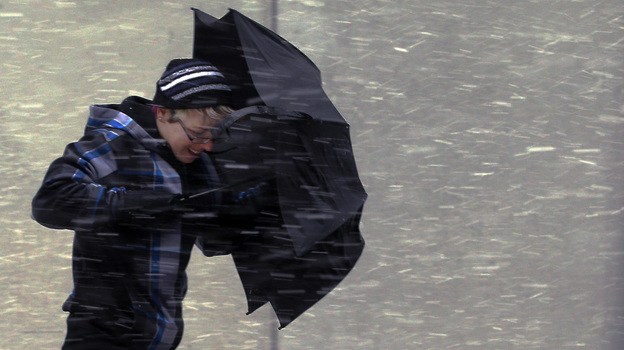 Battling the wind in Boston on Friday, as the storm moved in. (Reuters /Landov)