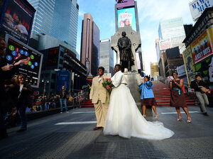 Chris (right) and Renee Wiley pose for a wedding photo on Times Square in New York in December. Same-sex marriage in New York state became legal in July 2011.