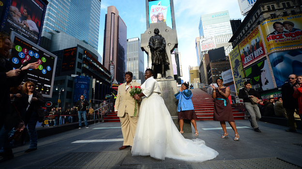 Chris (right) and Renee Wiley pose for a wedding photo on Times Square in New York in December. Same-sex marriage in New York state became legal in July 2011. (AFP/Getty Images)