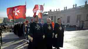 Knights of the Order of Malta walk in procession toward St. Peter's Basilica to mark the 900th anniversary of the Order of the Knights of Malta, on Saturday at the Vatican.