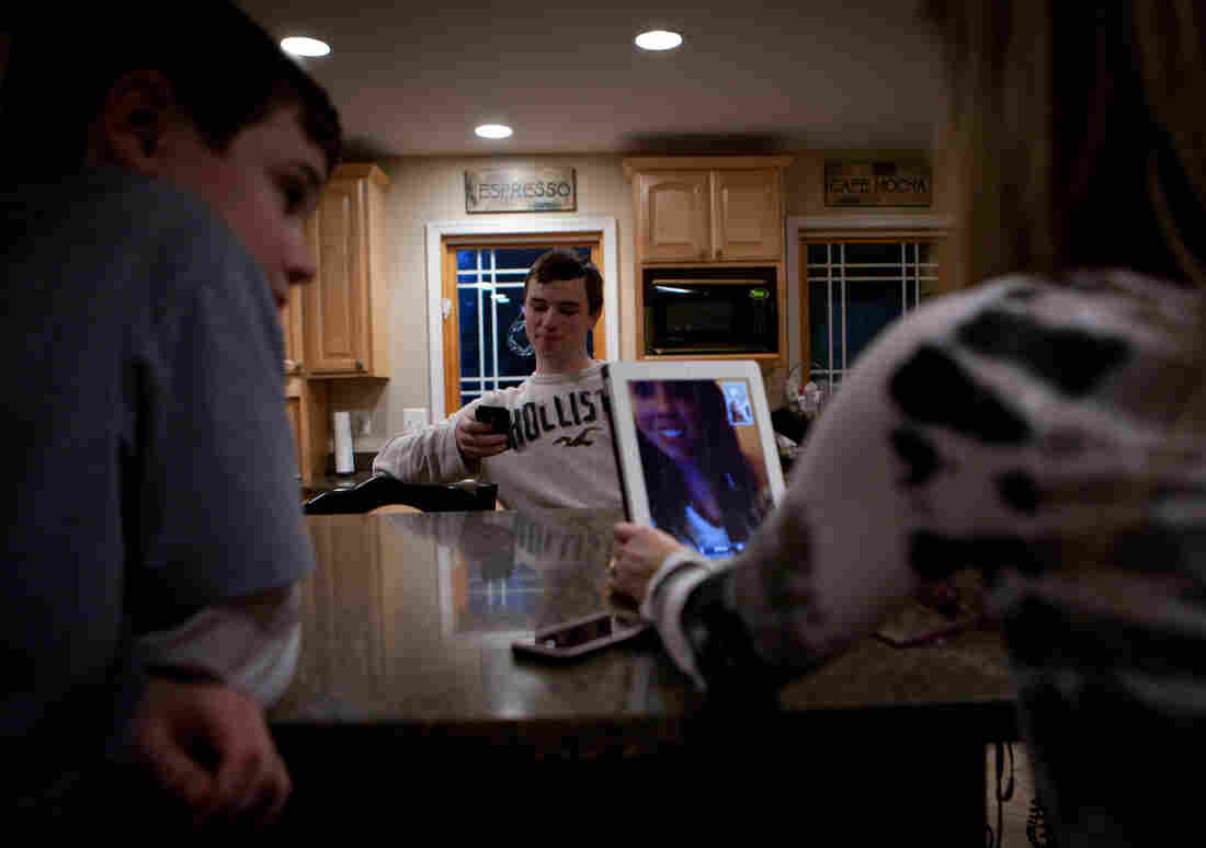 The Jordans use an iPad to talk to their daughter, Kelly, who's at school in Pennsylvania.