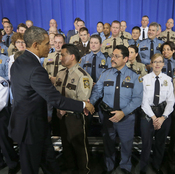 President Obama greets law enforcement officers after speaking on ideas to reduce gun violence at the Minneapolis Police Department Special Operations on Monday.