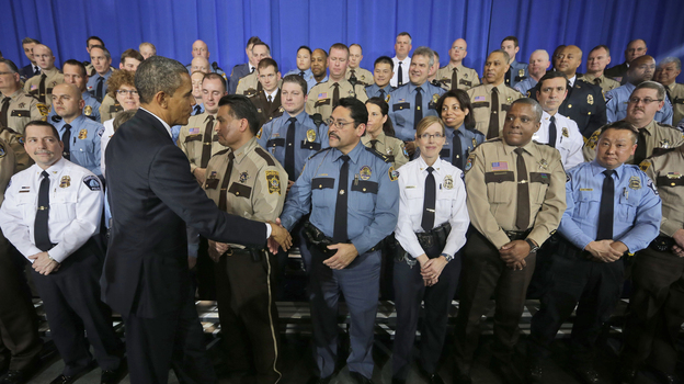 President Obama greets law enforcement officers after speaking on ideas to reduce gun violence at the Minneapolis Police Department Special Operations on Monday. (AP)