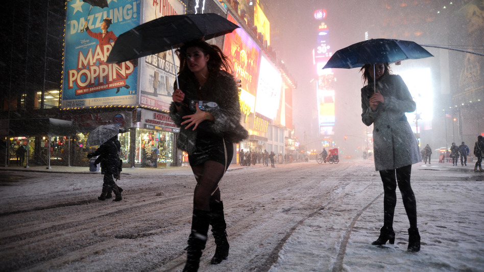 Two women look for a taxi in New York's Times Square on Friday. (AFP/Getty Images)