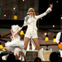 Taylor Swift gives the opening performance at the 55th Annual Grammy Awards Sunday in Los Angele