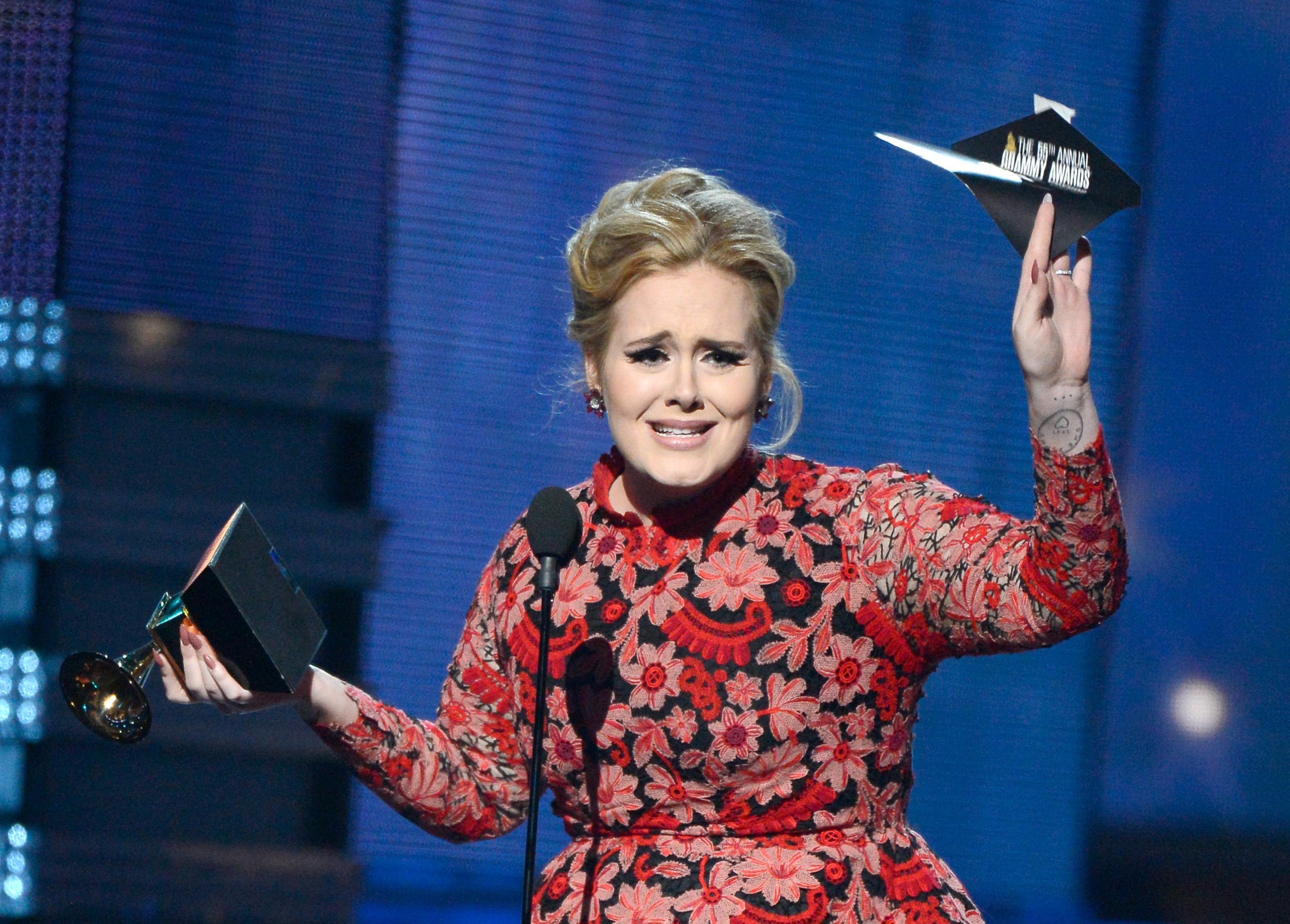 Adele accepts the Grammy for Best Pop Solo Performance for Set Fire to the Rain (Live).