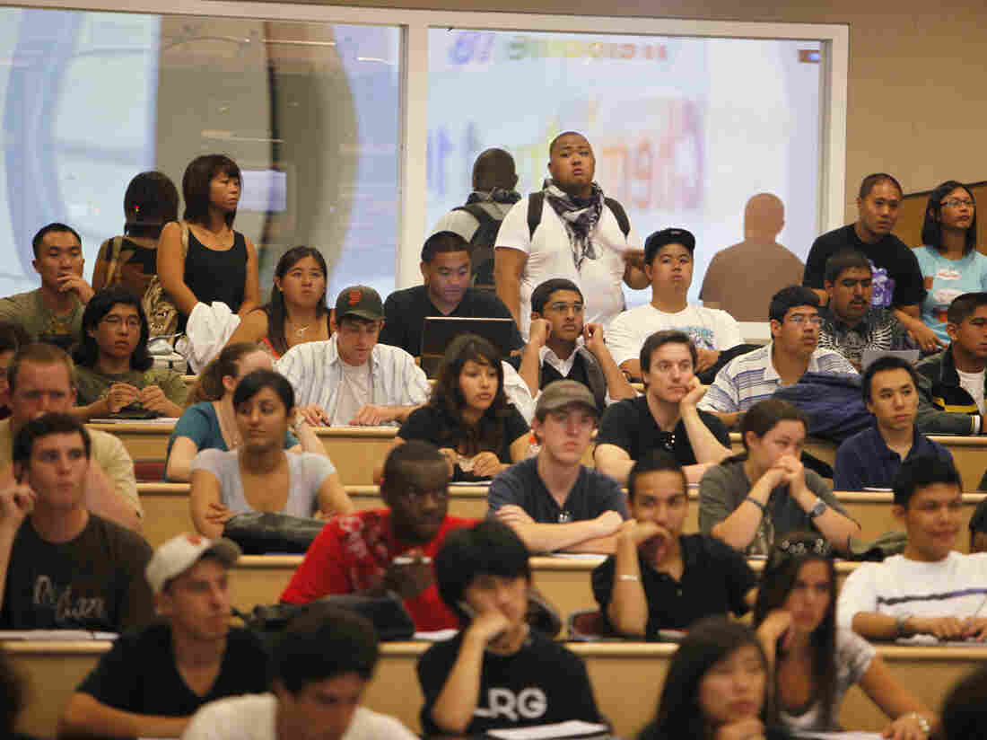 Students stand in the back row of a filled chemistry class at the California State University East Bay in Hayward, Calif., in September  2009. Officials from the Cal State system are seeking new prospective African-American students in church pews.