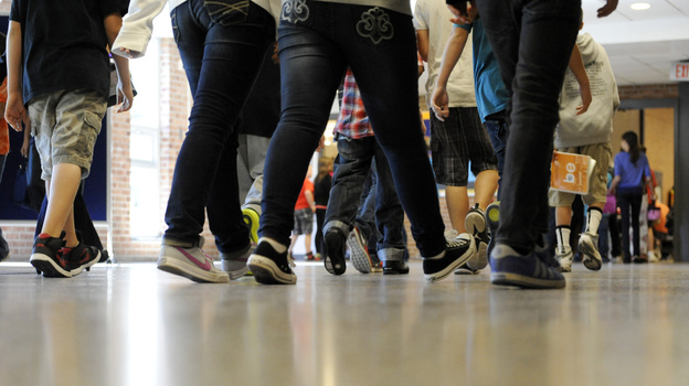 Students walk in the hallway as they enter the lunch line of the cafeteria at Draper Middle School in Rotterdam, N.Y. Five states announced in December that they will add at least 300 hours of learning time to the calendar in some schools starting in 2013. (AP)